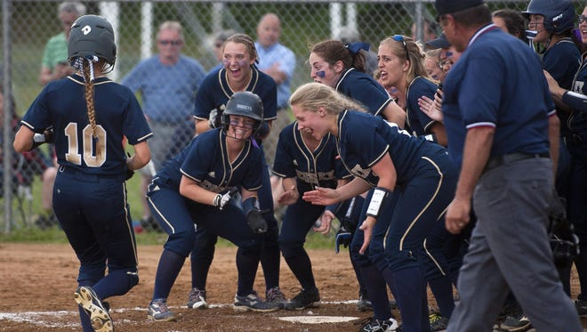 Essex players wait at home to celebrate a game-tying home run by Makenna Thorne (10) in the sixth inning against Colchester during Tuesday's Division I softball semifinal.