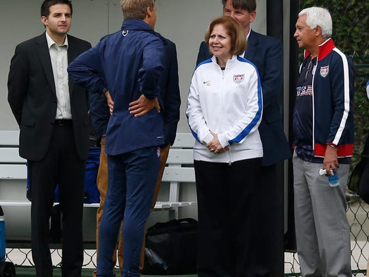United States' head coach Juergen Klinsmann, center left, talks to Liliana Ayalde, the U.S. ambassador to Brazil, during a training session at the Sao Paulo FC training center in Sao Paulo, Brazil, Wednesday, June 11, 2014. The U.S. will play in group G of the 2014 soccer World Cup. (AP Photo/Julio Cortez)