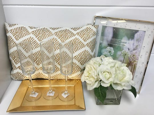 Shoppers can buy a champagne glass set or home accessories for the married couple at Welcome Home in Red Bank.