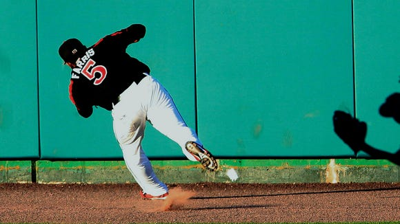 Red Wings outfielder Eric Farris casts a shadow as he makes the catch for an out in the third inning off the bat of Lehigh Valley's Grady Sizemore.