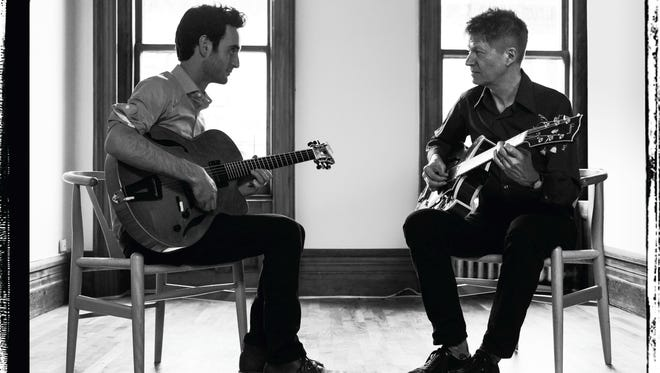 "Julian Lage, 26, at left, sits with Nels Cline, 58, in this cover photograph of their new album, ""Room."""