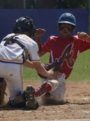 Wylie Junior League catcher Balin Valentine tags out Alice American's R.J. Carrillo at the plate in the first inning of Wylie's 3-1 win Tuesday at Kirby Park. The victory secured the Texas West state championship for Wylie.