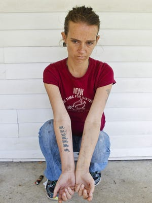 Matt Stone/The Courier-Journal Bobbie Jo Spencer, shown sitting outside the Austin, Ind., home she rents with six other people, said she is addicted to the painkiller Opana. She said she has tested negative for HIV, but she?s still nervous. Sitting outside the Austin home she rents with six other people, Bobby Jo Spencer is addicted to opana, which she uses regularly. She's been addicted to drugs for years. By Matt Stone, The C-J April 26, 2015