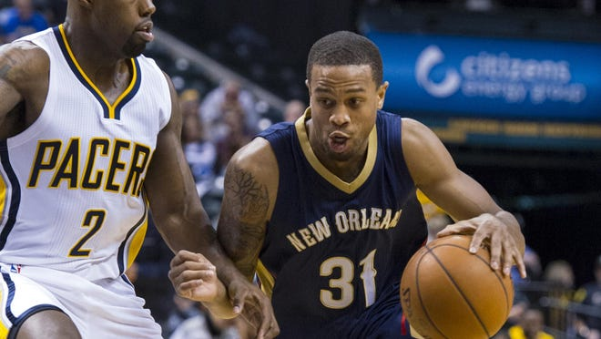 The New Orleans Pelicans' Bryce Dejean-Jones (31) drives the ball around the defense of the Indiana Pacers' Rodney Stuckey (2) during the first half of a preseason NBA game on Oct. 3, 2015, in Indianapolis.