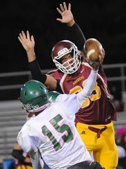 McCutcheon lineman Trent Dardeen deflects Dylan Barron's