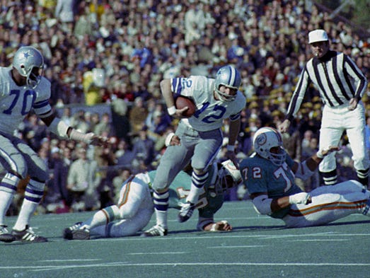 Super Bowl VI (Cowboys 24, Dolphins 3): Dallas Cowboys quarterback Roger Staubach (12) tries to escape the grasp of Miami Dolphins defender Jim Riley.