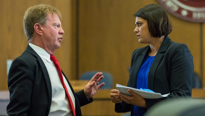 Prosecutor Davis Ruark, left, speaks with expert witness Raman Sandhu-Kirmer, forensic scientist with New Mexico Department of Public Safety DNA Crime Lab, on Tuesday May, 31, 2016,  as the court took a break during her testimony at 3rd Judicial District Court during the Tai Chan Trial.