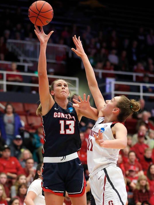 Jill Barta (13) takes a shot over Stanford forward Alanna Smith