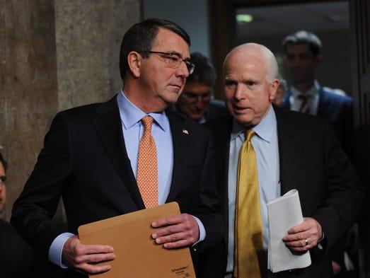 Secretary of Defense nominee Ashton Carter talks with