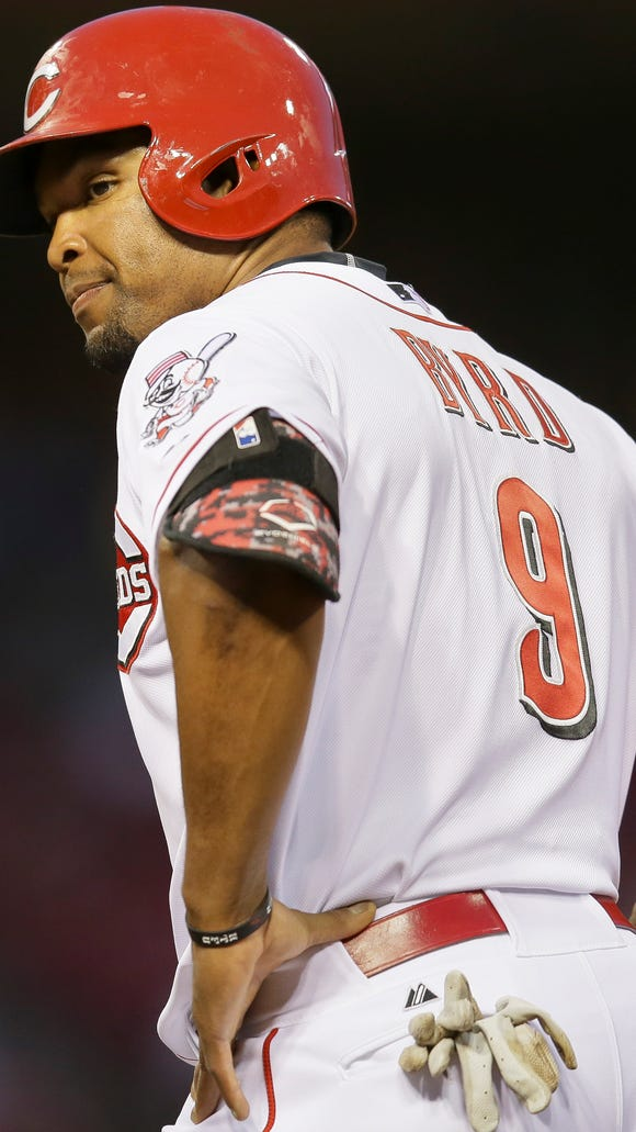Cincinnati Reds' Marlon Byrd stands on first after