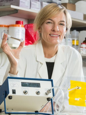 Colorado State University Microbiology, Immunology and Pathology professor Diane Ordway does research to create a breathalyzer for tuberculosis detection, May 2, 2014.