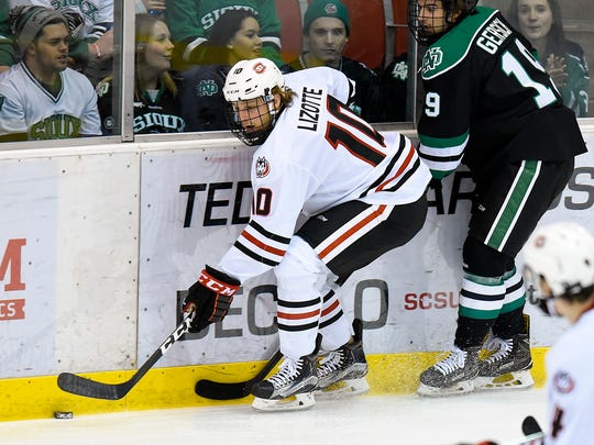St. Cloud State's Jon Lizotte gets the puck off the boards against the University of North Dakota during the first period Saturday, Nov. 19, 2016, at the Herb Brooks National Hockey Center.