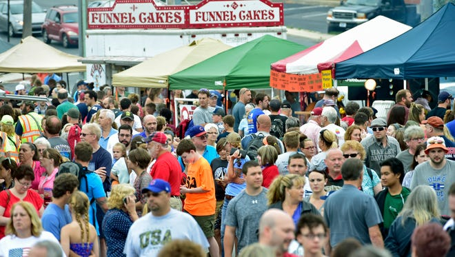 A crowd gathers for food and fun during  the craft show and children's games and activities. Waynesboro's 4th of July celebration was held along Main Street on Monday, July 4, 2016.