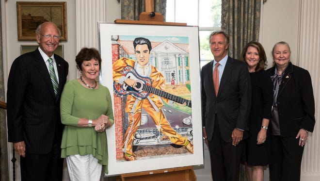 Governor Bill Haslam stands with a Red Groom Elvis painting.