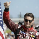 FILE - In this Feb. 22, 2015, file photo, Jeff Gordon gives a thumbs-up to the crowd as he in introduced before the Daytona 500 NASCAR Sprint Cup series auto race at Daytona International Speedway in Daytona Beach, Fla.