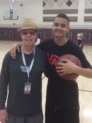Assistant coach Larry Bennett poses with Rancho Mirage basketball player Charles Neal.