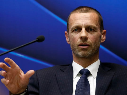 """UEFA president Aleksander Ceferin speaks during a news conference in Stara Pazova, near Belgrade, Serbia, Friday, March 31, 2017. FIFA wants to hold a new six-team playoff round in the 2026 World Cup host country to complete the expanded 48-team tournament lineup. Europe would be """"fairly represented"""" by the quotas, said Ceferin. (AP Photo/Darko Vojinovic)"""