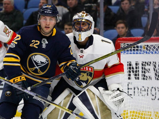 Buffalo Sabres forward Johan Larsson (22) skates in front of Florida Panthers goalie Roberto Luongo (1) during the first period of an NHL hockey game, Friday Nov. 10, 2017, in Buffalo, N.Y. (AP Photo/Jeffrey T. Barnes)