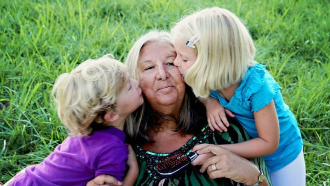 Cathy Robertson Simmons with two of her grandchildren.