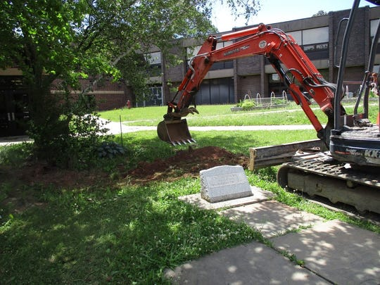 The bulldozer gets ready to start work on a rain garden installed earlier this year in the courtyard area of Highland Park High School. The new garden is already being used in a variety of ways, including for environmental science classes.