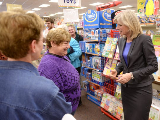 Gubernatorial candidate Mary Burke, right, talks with
