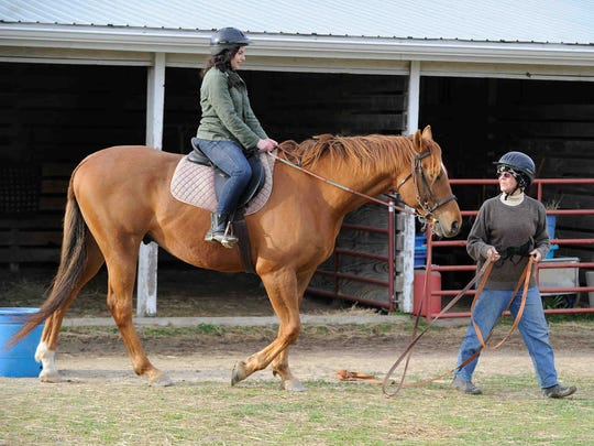 The News Journal's Jennifer Rini in Milton horseback riding at Kershaw Acres with Karen Kershaw and her horse Condo.
