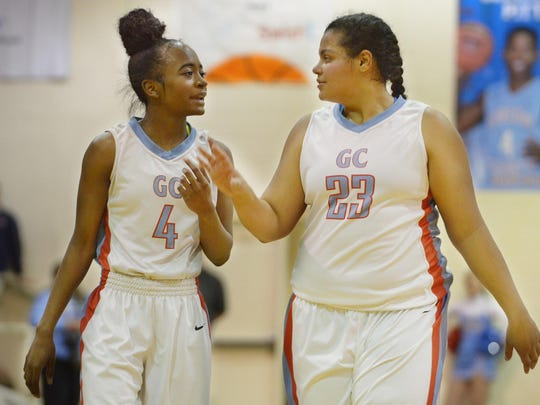 Gibson County's Briana Fields and Justyce White talk after a timeout during their Region 7-A championship game against Dresden Wednesday evening. Gibson County defeated Dresden, 55-52 in overtime.