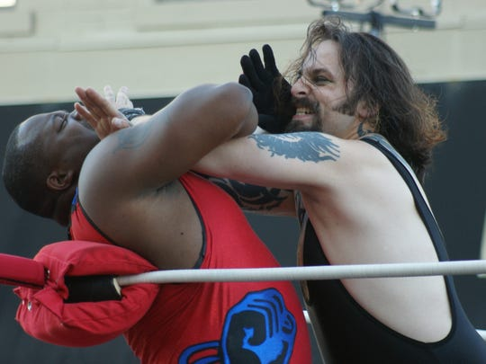 The Madness of Trip, right, ties up with Cyclone Jones during a match at 'Fight 4 Fremont.'