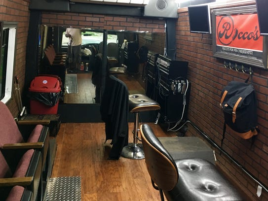 Inside the van Young outfitted as a traveling salon.