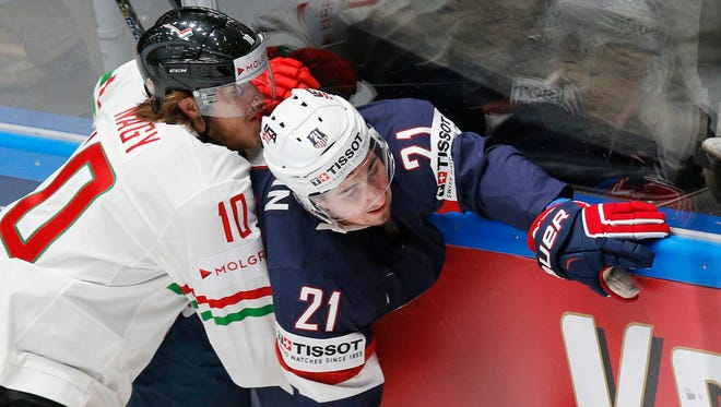 Hungary''s Gergo Nagy, left, vies with Dylan Larkin of the United States in St. Petersburg, Russia, on Friday, May 13, 2016.
