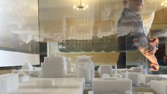 Members of the public view a scale model of the proposed Burlington Town Center redevelopment project. Photographed Tuesday, Aug. 9, 2016.