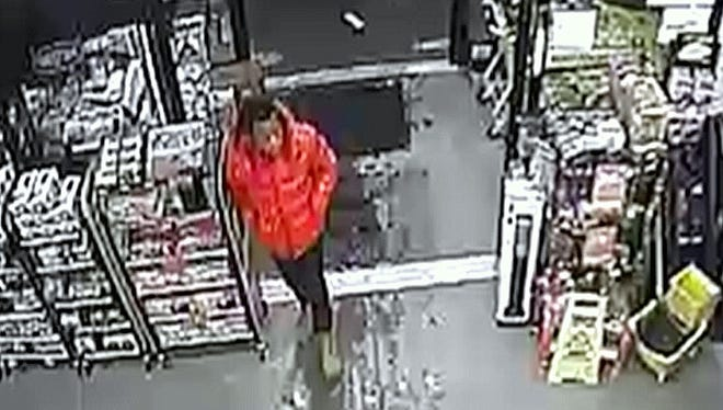 This surveillance photo shows a man suspected of passing counterfeit money leaving a Dollar General store in Avoca.