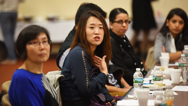 Eunhye (Grace) Kim of NYC, Program Manager at Korean Community Services of Metropolitan NY Inc., asks questions to the elected officials and US Department of Health and Human Services representatives during the announcement of new Asian-American enrollment outreach initiatives through the hospital's Asian Health Services Program, photographed at Holy Name Medical Center in Hackensack on Nov. 29, 2016.  Mitsu Yasukawa