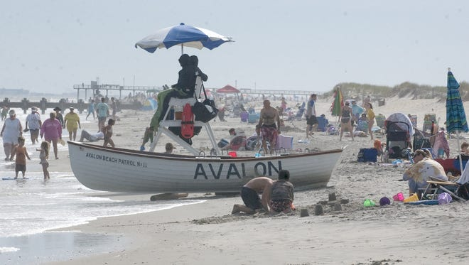 Authorities allege George Barnard defrauded mortgage firms to buy three beach homes in Avalon.