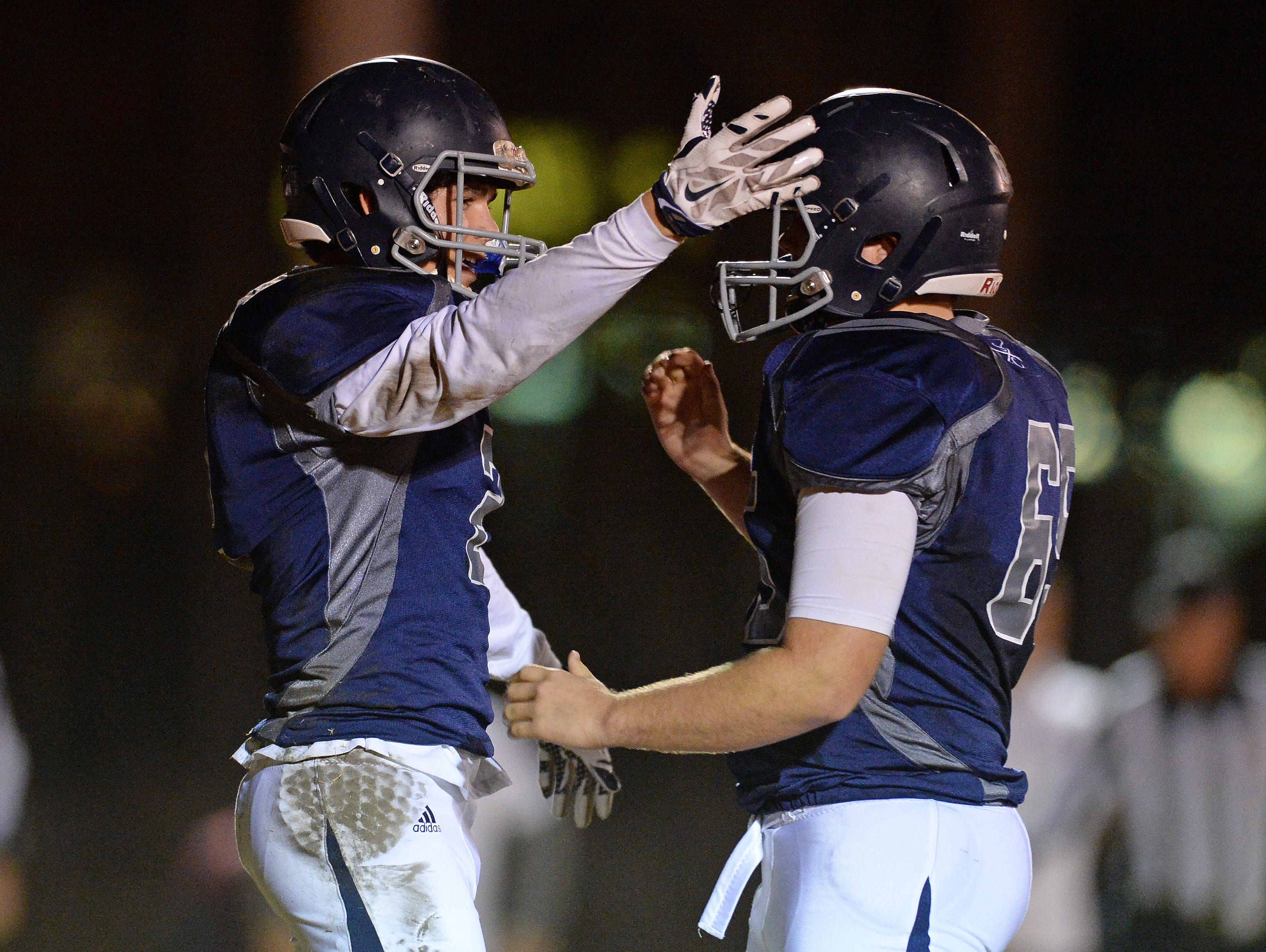 Southside Christian's Cooper Jackson (2) celebrates with teammate Connor Wheatley (65) after catching a TD against McBee during the Class A Division I playoffs Friday, November 27, 2015.