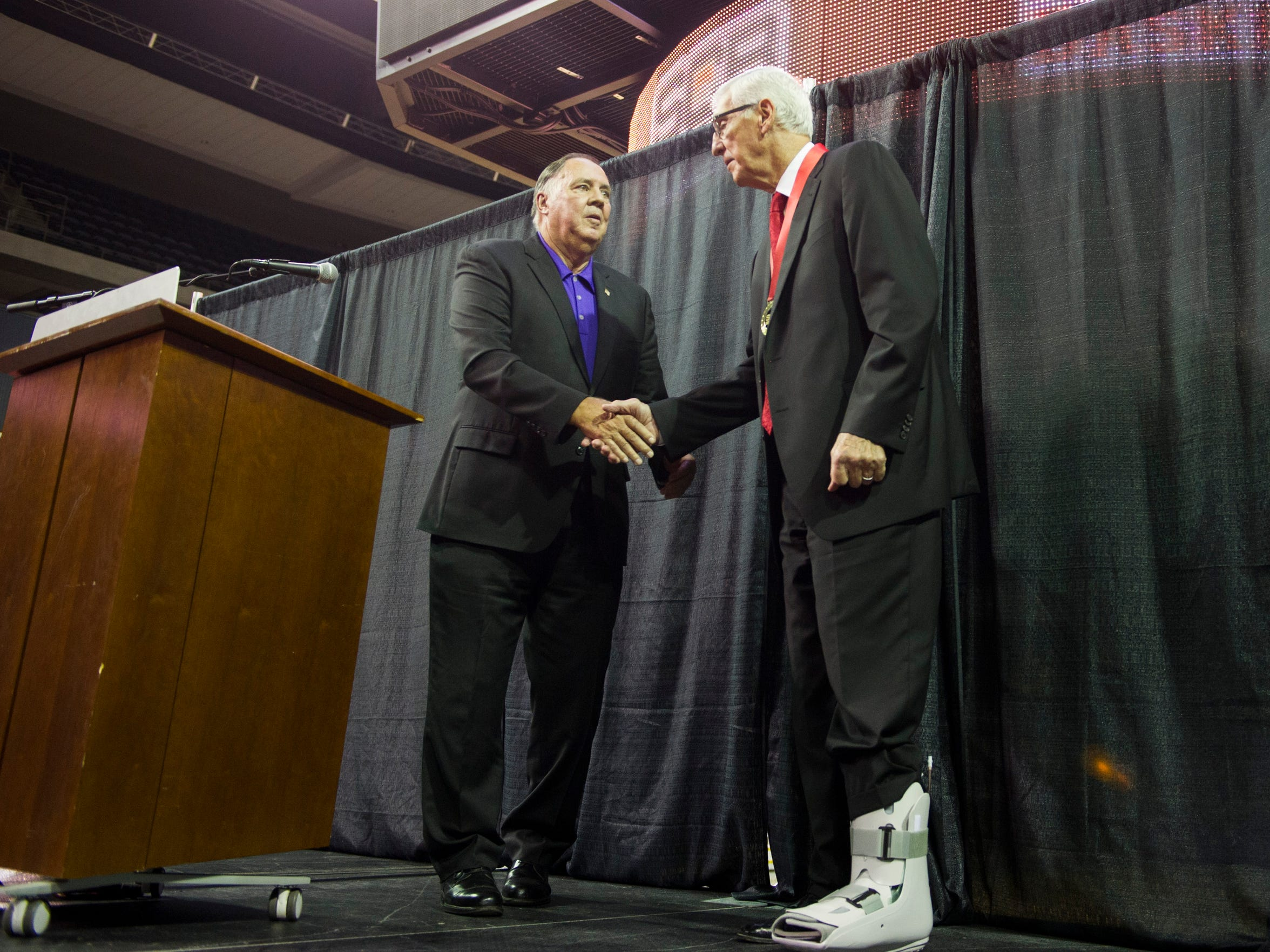 Wayne Boultinghouse, congratulates Jerry Sloan as he