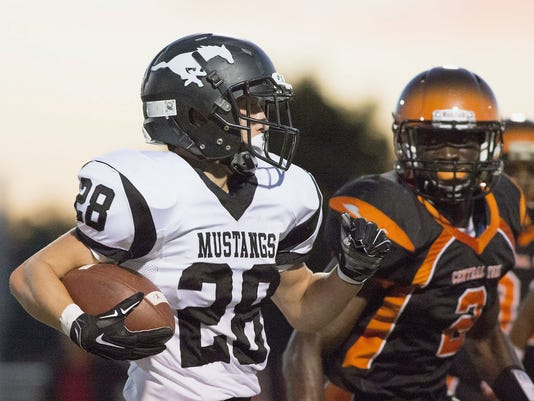 South Western's Andrew Hartlaub gets run down by Central York's Jeremiah DadeboeFriday, Sept. 26, 2014.        JOHN WHITEHEAD for the Daily Record/Sunday News