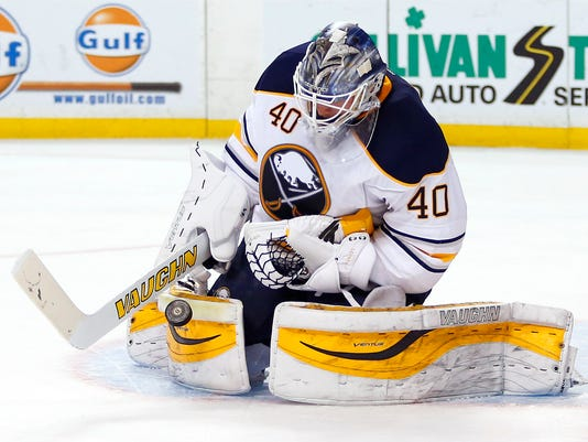 Buffalo Sabres goalie Robin Lehner makes a save against the Boston Bruins during the second period of an NHL hockey game in Boston Saturday, Feb. 6, 2016. (AP Photo/Winslow Townson)