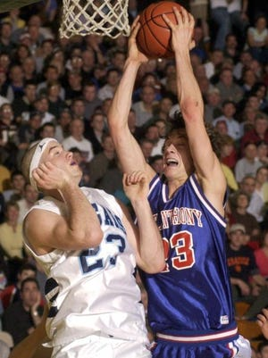 A.J. Mahar (right) grabs a rebound against Mount Mansfield in Division I semifinals in 2004.