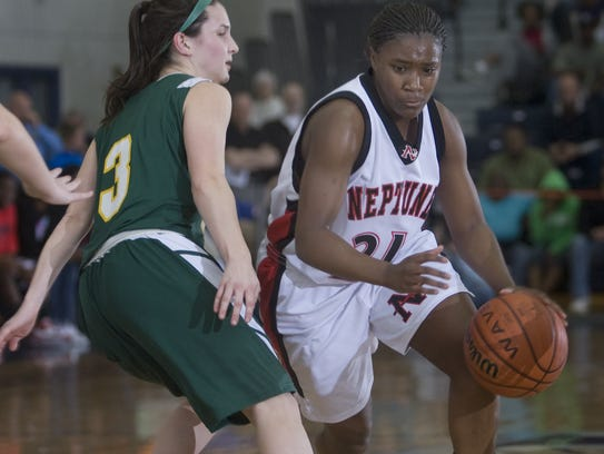 Neptune's Shakena Richardson drive to basket past North