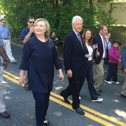 Hillary and Bill Clinton march in the New Castle Memorial