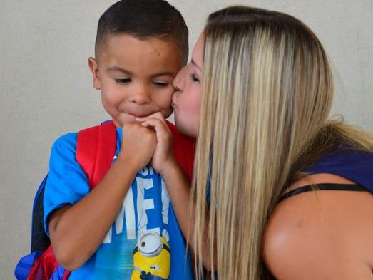 Joseph Landin, 5, waits for school to start as his mother, Amanda Vawter, kisses him goodbye.  Wednesday was back to school for more than 800 Sundale Elementary School students. Sundale Union was among the first school districts to go back to school.