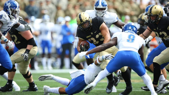 Army junior Darnell Woolfolk rushed for 132 yards and three touchdowns in Army's 31-28 overtime victory over Temple on Oct. 21.