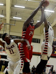 South Side's Chris McNeal goes up for a rebound with Lexington's Tariqious Tisdale as McNeal's teammate Terrikous Smith looks on during their game Friday.
