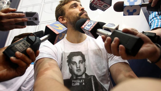Wearing an Elvis Presley shirt, Memphis Grizzlies center Marc Gasol reflects on the season as he talks with the media during exit interviews at the FedExForum on May 4, 2014.