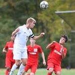 Action from Wednesday's soccer game between Arlington and Roy C. Ketcham.