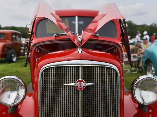 A red 1935 Chevrolet gleams in the street rod section during Sunday's Pantowner's Annual Car Show and Swap Meet at the Benton County Fairgrounds.