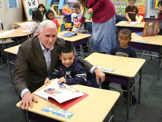 Gov. Mike Pence gets a photo taken with preschool student Edgar Gomez while visiting preschool classes at Shepherd Community Center, 4107 E. Washington St., in February. Pence decided last week not to apply for an $80 million federal preschool development grant.