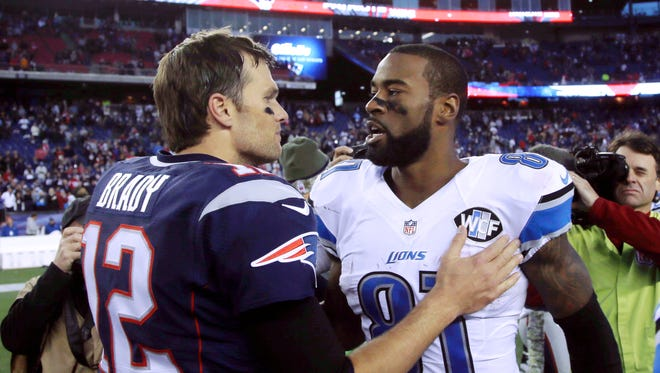 New England Patriots quarterback Tom Brady (12) speaks to Detroit Lions wide receiver Calvin Johnson (81) after their NFL football game Sunday, Nov. 23, 2014, in Foxborough, Mass.