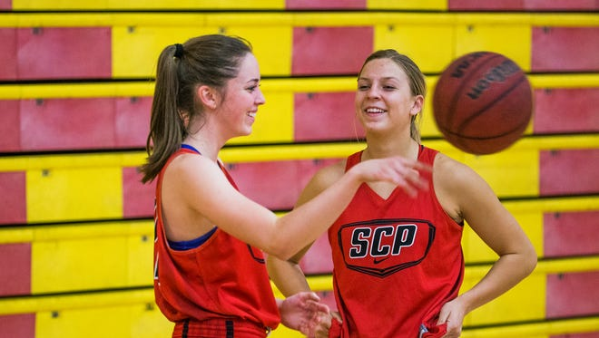 Sarah Barcello, left, and Liz Holter, of the Seton Catholic High School girls basketball team , practice with the team, November 14, 2016.
